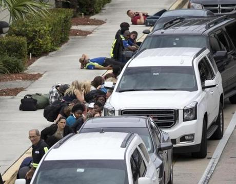 People took cover outside Fort Lauderdale's airport.